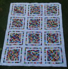 Great way to use up those postage stamps!   I wish the picture were brighter.  Very pretty quilt.