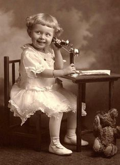 +~+~ Antique Photograph ~+~+  Very happy girl playing with a toy phone