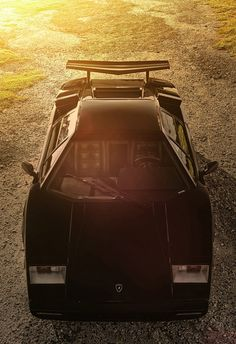 Lamborghini Countach - Every young boy had a poster of a countach adorning their bedroom walls. As mad a box fo frogs but probably the most exotic car ever produced.