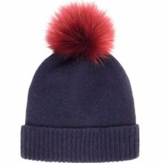 Helen Moore Pom Pom Beanie - Navy Burgundy : The navy blue of the cashmere beanie contrasts beautifully with the fluffy Burgundy faux fur pom-pom.  -Made in Scotland from 100% cashmere -A touch of luxury for your winter wardrobe -One size