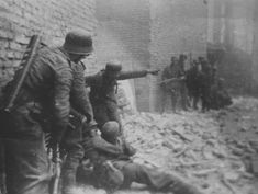 German soldiers prepare to evacuate the wounded during a battle with the Warsaw insurgents on the ruins of the Old City (District Bank of Poland). September 18, 1944. Pin by Paolo Marzioli