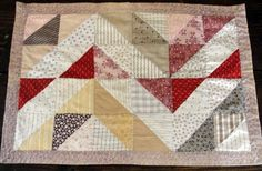 Antique flying geese doll quilt seen at Vintage Blessings on eBay