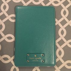 Kate Spade IPad Mini Case Green leather cover, black backing with Kate Spade logo on both sides. Pop out stand for propping up iPad kate spade Other