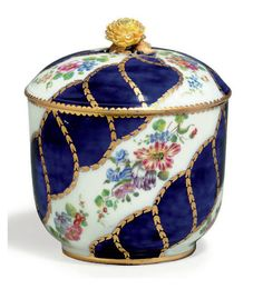A VINCENNES PORCELAIN BLEU LAPIS SUGAR-BOWL AND COVER (POT A SUCRE 'BOURET', 1ERE GRANDEUR) BLUE INTERLACED L'S ENCLOSING DATE LETTER D FOR 1756-57, PAINTER'S MARK FOR MEREAUD, MARK OF TWO BLUE DOTS TO THE FOOTRIM LIKELY FOR THE GROUND PAINTER