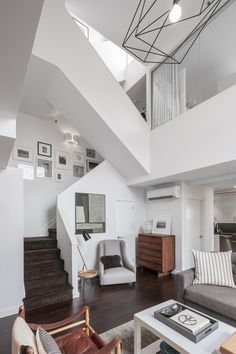 The duplex apartment takes up the top floors of an eight-story building that was built back in the 1880s. #refinery29 http://www.refinery29.com/2016/04/108928/alexis-bledel-vincent-kartheiser-brooklyn-heights-penthouse-apartment#slide-1