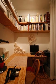 High up double stacked book shelf around the corner
