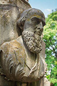 Memphis Elmwood Cemetery - Resting On His Laurels © Jon Woodhams. A beautifully sculpted bust of a bearded man rests on laurel leaves, marking a grave at Memphis's famed Elmwood Cemetery. Prints and cards available here: http://fineartamerica.com/featured/memphis-elmwood-cemetery-resting-on-his-laurels-jon-woodhams.html and here: http://www.artflakes.com/en/products/memphis-elmwood-cemetery-resting-on-his-laurels #elmwoodcemetery #memphis #elmwood #laurels