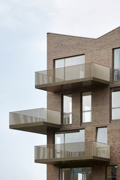 Simple brickwork and golden steel used for canalside housing.  barefootstyling.com