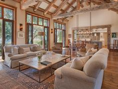 open concept, rustic wood beams kitchen, family room