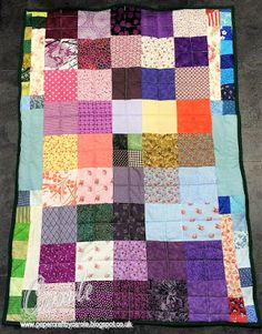 Scrappy Quilt made from all sorts of fabrics, and bound with green cotton. Designed by Carole Davis #papercraftbycarole #sewing #quilting #janome #patchwork