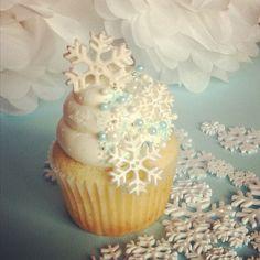 Fondant snowflakes with vanilla swiss meringue buttercream on vanilla cakes.