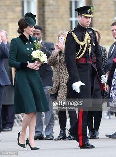 Catherine Duchess of Cambridge and Prince William Duke Of Cambridge presents the 1st Battalion Irish Guardsmen with shamrocks during the annual Irish...