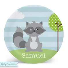 Child's Plate - Raccoon Melamine Bowl or Plate Custom Personalized with Childs Name. This cute raccoon plate or bowl is a perfect gift. Bowls are 20 oz., plates measure 10 inches. Both are made from melamine, are non-toxic, bpa-free, dishwasher safe, and made for everyday use. Sweet raccoon on an outdoor scene background--original illustration by BitsyCreations. Choose plate or bowl--or grab a set and save! Your choice to put a name or not. Please be sure to double-check spelling if…