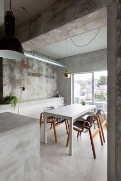 """Concrete apartment featuring display space for """"precious clothes"""""""