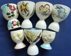 .hand painted egg cups, highly collectible
