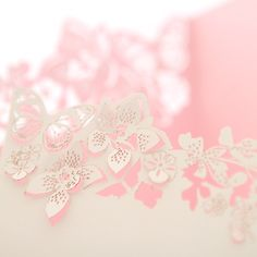 Custom orchid and butterfly laser-cut invites - very pretty and expensive package