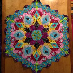 I'm stunned by the scale of this thing. Rosette ONE done. #EPP #thenewhexagonmillefiorequiltalong #hexies #millefiorequiltalong