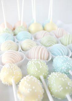 Elegant cake pops. I love the little white sprinkles.