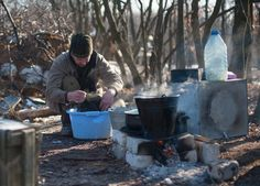 And still life goes on: a Ukrainian serviceman washes his clothes on the road to Bakhmutka, near Luhansk.
