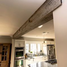 Beams for ceilings and mantle shelves made from reclaimed barn house wood. We transform the materials to make your home stand out Fake Wood Beams, Exposed Beams, Fake Beams Ceiling, Wood Ceilings, Rustic Kitchen, Craftsman Kitchen, Home Kitchens, Farmhouse Kitchens, Home Remodeling