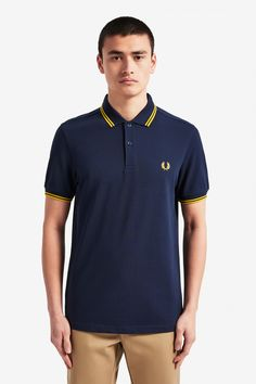 The Twin Tipped Fred Perry shirt. Made from our classic cotton piqué, in a contemporary fit. The has slightly slimmer proportions than our original tennis shirt, with neat cuffs and collar. Polo Shirt Outfits, Polo T Shirts, Nike Outfits, Fred Perry Polo Shirts, Fred Perry Shirt, Polo Shirt Design, Pique Shirt, Twin Tips