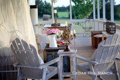 Antique Iron Bed on a summer decorated porch- Cedar Hill Farmhouse