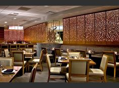 Two sets of laser cut wood panels, internally lit, make a dramatic background to this restaurant.  Crowne Plaza O'hare hotel, Chicago