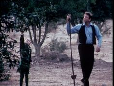 johnny cash's daughters | Johnny Cash and one of his children pick apples in a scene from Johnny ...