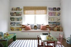 Book corner with front facing book shelves and a window seat