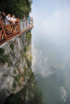 ZHANGJIAJIE, CHINA - AUGUST 01:  Tourists walk on the 100-meter-long and…