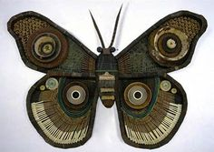"""""""Michelle Stitzlein creates found object art / sculpture from recycled materials, including piano keys, broken china, license plates, rusty tin cans, electrical wire, bottlecaps, and other miscellaneous items."""""""