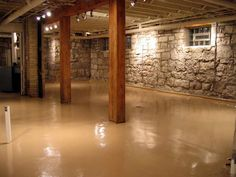 Rustic Finished Basement Theme With Natural Wood Pillars And ...