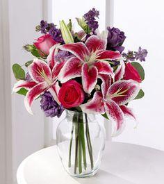 Stargazer Lilies, Purple Lisianthus, Larkspur with Silver Dollar Eucalyptus