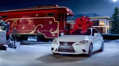 """According to luxury car makers, the hot gift this Christmas is a car with a giant red bow. But where do they get those giant red things from? We tracked down the creator of those festive ribbons and met the woman who works in """"bow kingdom."""""""