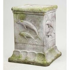Small pedestal with dolphins on it. A unique design perfect for displaying product statutes or water themed pieces. Shown here with a white moss finish. A great size for a potted plant or urn.