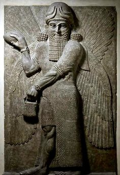 "Statue relief known as ""Blessing Genius - from Neo-Assyrian culture, circa 750-700 BCE - at the Louvre Museum"
