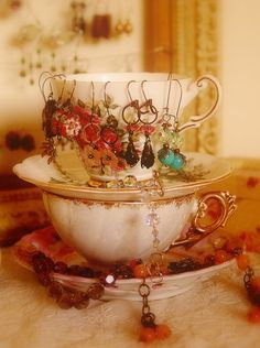 Teacup jewerly holder display for arts and craft shows, art booth, retail store fixture for earrings; Upcycle, Recycle, Salvage, diy, thrift, flea, repurpose! For vintage ideas and goods shop at Estate ReSale & ReDesign, Bonita Springs, FL