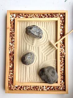 Mini Zen Garden: sand, rocks, and border pulses representing pebbles