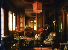TONY DUQUETTE'S COW HOLLOW. The upstairs hall was reached by a exterior spiral staircase and the room decorated with 19th Century English Regency Chinoiserie bamboo panels and 18th century French and English furniture.