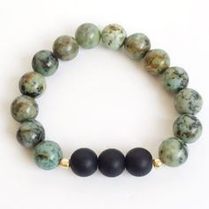 Sale- Matte black and African Jasper bracelet Matte black beads strung with African Jasper beads on elastic cord, measures 7 inches around Immeasurably More Jewelry Bracelets