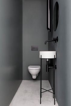 If you have a teeny tiny or small bathroom, here's an idea for you! Use the look of a narrow bathroom and paint the walls a solid color other than white. To be bold, go for a darker grey hue and add black. This is a super easy small bathroom remodel project that will stick to your budget!