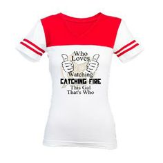 Who Loves Catching FireThis G Jr. Football T-Shirt Who Loves Catching Fire This Girl that's Who, with the mockingjay in the backround. Find this design on more great gift merchandise.  $21.59
