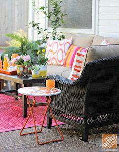 Rustoleum's Real Orange is the perfect shade of tangerine for this side table. It perfectly complements Cassie of Hi Sugarplum's lively outdoor space! #paint