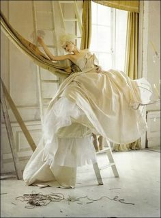 SHOOT 9 - Abandoned location, lots of white walls and light, propped on ladders with dramatic cageskirt or gown.