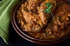 Moroccan Style Braised Chicken Breasts with Warm Spices, Chickpeas and Tomatoes over Lemon-Almond Couscous
