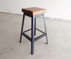 This is a simple bar stool I made out of angle iron with a walnut seat.The angle iron was recycled from some old bed frames, and the wood was from a piece of walnut...