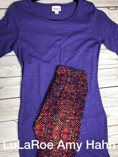 This XS Julia is super cute! It's got purple micro lines in it that give it a textured look. The OS leggings are super fun! $70 plus tax and free shipping  Shop my VIP Group for all your Comfy and Cozy LulaRoe Outfits! >>>> https://www.facebook.com/groups/lularoeamyhahn/  #lularoe #leggings #outfit #comfort #style