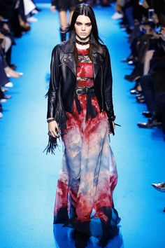 In Elie Saab's fall 2016 Ready-to-Wear fashion show, they make a reference to the 1960's here with this leather jacket that the model is wearing. In the 1960's, there were several different style tribes going on. There was the rocker style tribe which is where leather jackets and motorcycles originated from. Since then, leather jackets have always been a staple in women's and men's fashion. This leather jacket is definitely more modern than the 60's but combines styles from other eras as…