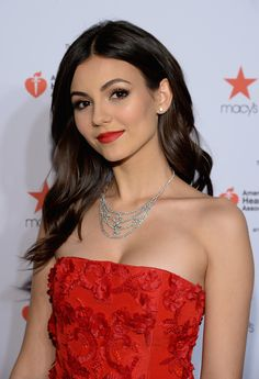 Victoria looked stunning at the Red Dress Collection show with a gorgeous blowout and matte red lips.