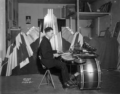 Side profile picture of drummer - 1937. Check out the old school double bass pedal.